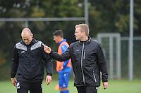 VOETBAL: HEERENVEEN: 21-10-2015, Sportpark Skoatterwâld, SC Heerenveen training onder leiding van Foppe de Haan, assistent trainer Tieme Klompe (rechts), Keepertrainer Harmen Kuperus, ©foto Martin de Jong