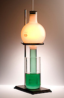 PHOSPHORUS MOON DEMONSTRATION<br /> (1 of 4 - Variations Available).<br /> Combustion of Red Phosphorus in Oxygen Atmosphere<br /> This spontaneous process produces a characteristic yellow-white glow. The product of the combustion is phosphorus pentoxide P2O5. A vacuum is created by the combustion which draws the water in the beaker up the tube of the flask.
