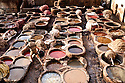 At the leather tanneries in Fez the tanning of hides continues in the same manner as it has for at least nine centuries.  The hides are first soaked in diluted pigeon excrement to soften the hide, then are soaked in vegetable dyes, left to dry, and then cut into patterns that are made into various products for sale.