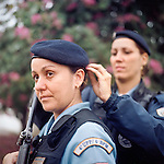 Patrol officers Luciana Montanari, 32, left, and Carla Bonn, 33, right. <br /> Rapid Response Team<br /> Pacifying Police Unit<br /> Complexo do Caju, Rio de Janeiro, Brazil