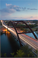 Evening falls over the 360 Bridge outside of Austin, Texas. Finished in July of 1982, Pennybacker Bridge rises 100 feet above the cool waters of Lake Austin (the Colorado River) as those waters flow into downtown Austin.
