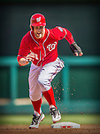 15 September 2013: Washington Nationals outfielder Bryce Harper hustles from second to third during game action against the Philadelphia Phillies at Nationals Park in Washington, DC. The Nationals took the rubber match of their 3-game series 11-2 to keep their wildcard postseason hopes alive. Mandatory Credit: Ed Wolfstein Photo *** RAW (NEF) Image File Available ***