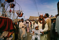 People come for miles to camp in the desert for a camel mela so their animals will be blessed.  Part of the celebration includes a carnival with rides and side shows.
