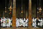 Ethiopian pilgrim-tourists wait in line to enter the Grotto, Jesus' birth place in the Church of Nativity in Bethlehem, West Bank.
