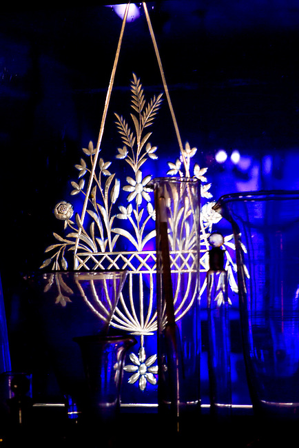 Gold glowing etched glass design of a hanging flower pot on glass ...