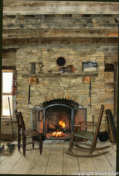 Log cabin interior elaine h biber for Cabin fireplace pictures