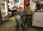 """Everett Marshall talked to customers over breakfast on Thursday, September 30, 2010 at Sue's Pantry.  Pictured in the foreground is Robert Mann who gave the advice, """"when you're in eastern Kentucky, prepare for the worst, 'cuz we got it."""" .Photo by Latara Appleby"""