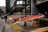 New York, New York.October 30, 2012..Destruction resulting from hurricane Sandy in lower Manhattan as building workers begin cleaning up the entrance to a flooded garage.