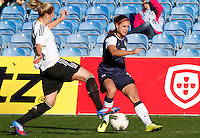 US's Alex Morgan fights for the ball with Germany's Luisa Wensing during their Algarve Women's Cup soccer match at Algarve stadium in Faro, March 13, 2013.  .Paulo Cordeiro/ISI