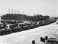 L.S.T.'s lined up and waiting for tanks to come aboard.  Two days before invasion of Sicily.  La Pecherie, French Naval Base. Tunisia, July 1943.  (OSS)<br /> Exact Date Shot Unknown<br /> NARA FILE #:  226-FPL-2665(A)<br /> WAR &amp; CONFLICT BOOK #:  1022