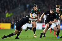 Handre Pollard of South Africa takes on the New Zealand defence. Rugby World Cup Semi Final between South Africa and New Zealand on October 24, 2015 at Twickenham Stadium in London, England. Photo by: Patrick Khachfe / Onside Images