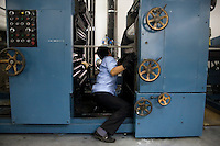 "A press technician cleans press plates in the Amity Printing Company's new printing facility in Nanjing, China....On May 18, 2008, the Amity Printing Company in Nanjing, Jiangsu Province, China, inaugurated its new printing facility in southern Nanjing.  The facility doubles the printing capacity of the company, now up to 12 million Bibles produced in a year, making Amity Printing Company the largest producer of Bibles in the world.  The company, in cooperation with the international organization the United Bible Societies, produces Bibles for both domestic Chinese use and international distribution.  The company's Bibles are printed in Chinese and many other languages.  Within China, the Bibles are distributed both to registered and unregistered Christians who worship in illegal ""house churches."""