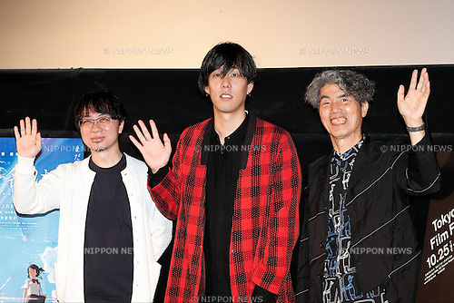 (L to R) Director Makoto Shinkai, singer/songwriter Yojiro Noda of Japanese band RADWIMPS and Kohei Ando Japan Now Programming Advisor, greet to the cameras during a stage greeting for the animated movie Your Name at Toho Cinemas in Roppongi Hills on October 27, 2016, Tokyo, Japan. The anime movie has topped the Japanese box office for 9 weeks running already generating over US$157 million and is now the 9th highest earning film ever released in Japan. The RADWIMPS soundtrack for the film has also topped Japan's music charts. Your Name will be released internationally in November 2016. The screening is part of the 29th Tokyo International Film Festival which is one of the biggest film festivals in Asia. TIFF runs from October 25 until November 3. (Photo by Rodrigo Reyes Marin/AFLO)