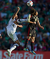 Pasadena, CA - June 25, 2011: Jermaine Jones, left, and Andres Guardado (18) battle for a ball during the United States vs Mexico match in the 2011 CONCACAF Gold Cup Championships, at the Rose Bowl. Mexico won 4-2.
