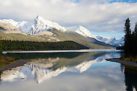 Leah Peak and Sampson Peak reflect in the waters of  Maligne Lake in Jasper National Park