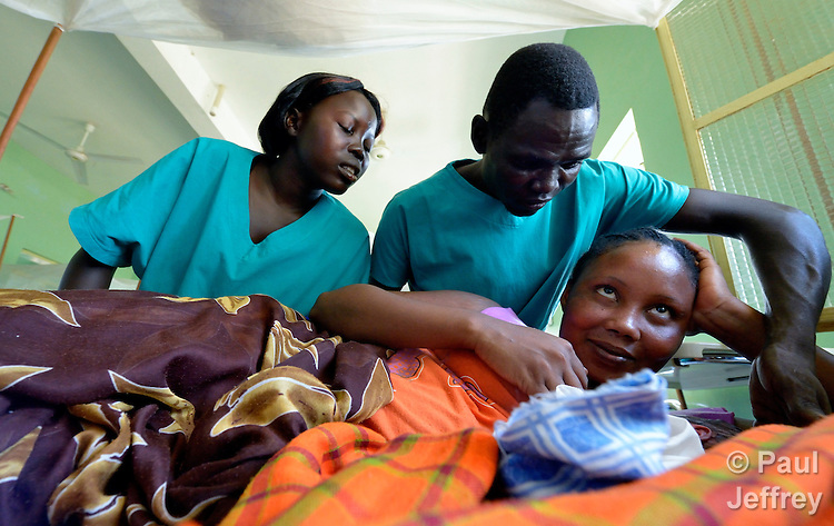 Jully Muja (left) and Kukani Tutu assist a mother following childbirth in the St. Daniel Comboni Catholic Hospital in Wau, South Sudan. Muja and Tutu are student nurses from the Catholic Health Training Institute in Wau. Health care is minimal in the newly independent country, and many religious groups are providing personnel and training to fill the gap. The Institute is coordinated by Solidarity with South Sudan, an international consortium of more than 200 religious congregations that trains teachers, health workers and pastoral personnel in several locations throughout South Sudan..