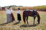 Dressing in period outfits during the Morgan Horse-Powered Field day at at a Deerfield Wisconsin Farm September 19, 2009.
