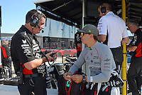 9-10 July, 2016 Newton, Iowa USA<br /> Graham Rahal (#15) talks with a crew member.<br /> &copy;2016, F. Peirce Williams