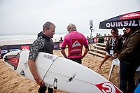 GREG EMSLIE (ZAF) and ADRIAN BUCHAN (AUS)SEIGNOSSE, France (Thursday, September 24, 2009) -The Quiksilver Pro France, Event No. 7 of 10 on the 2009 ASP World Tour, got back in motion today at the event's main venue of Les Bourdaines in consistent-but-testing five-foot (1.5 metre) waves...Battling against the elements with strong currents coming into the equation, Round 2 competitors put on a show of strategic game plans and athletic skills, holding their line-up positions and taking off on fast-breaking five-to-six foot wave faces to grab their Round 3 tickets...With most top seeds getting the job done in various ways, from solid scores to tight heat results, surprise came with the eliminations of highly-touted competitors Jeremy Flores (FRA), and defending champion Adrian Buchan (AUS), losing to Aritz Aranburu (EUK),  and ASP Dream Tour veteran Greg Emslie (ZAF), respectively, creating the biggest upsets of the day. The event has a waiting period from September 23rd to October 4 2009. The Quiksilver Pro France is a mobile event and depending on conditIons can be held at either Hossegor, Seignosse, Capbreton or Saint Jean de Luz and is designed to take advantage of the best waves on any given day the Atlantic Ocean has to offer in the South West region of France. Photo: joliphotos.com
