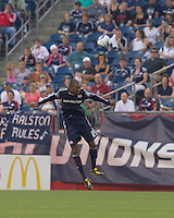 New England Revolution defender Cory Gibbs (12) heads the ball. The Chicago Fire defeated the New England Revolution, 1-0, at Gillette Stadium on June 27, 2010.