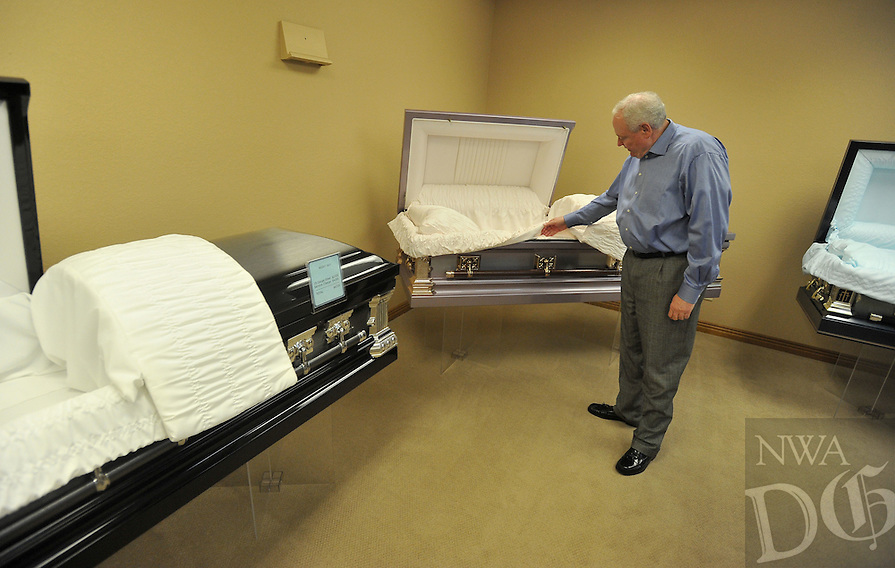 NWA Democrat-Gazette/MICHAEL WOODS &bull; @NWAMICHAELW<br /> Tommy Holland, with Beard's Funeral Chapel in Fayetteville, shows a selection of caskets at the Fayetteville Funeral Chapel Tuesday November 3, 2015.