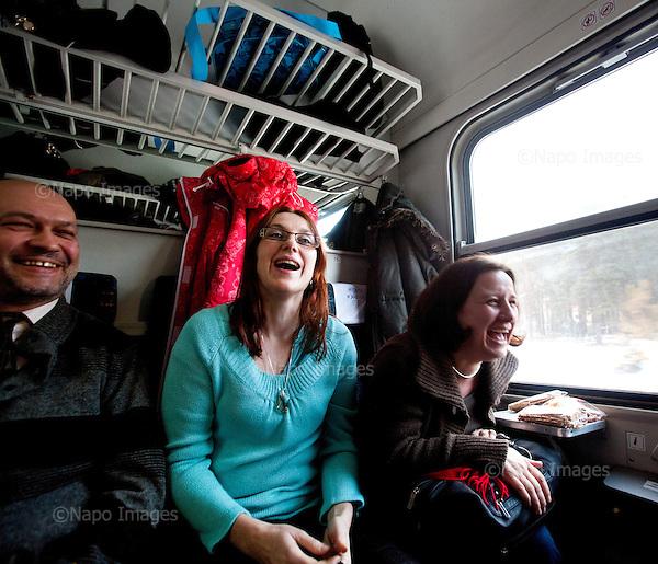 CENTRAL POLAND, FEBRUARY 2012:.Alfred, Meggi, Zosia in train from Warsaw. They commute from Skierniewice, Zyrardow and Lodz. About 500 thousand people commute everyday from other towns and villages to work in the Polish capital..(Photo by Piotr Malecki / Napo Images)..Luty 2012:.Alfred, Megi, Zosia w pociagu z Warszawy. Codziennie dojezdzaja do pracy ze Skierniewic, Zyrardowa i Lodzi. Okolo 500 tysiecy osob dojezdza codziennie z innych miast do pracy w Warszawie.  .Fot: Piotr Malecki / Napo Images