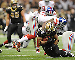 New Orleans Saints Pierre Thomas (23) vs. New York Giants Kenny Phillips (21) at the Superdome in New Orleans, La. on Monday, November 28, 2011. New Orleans won 49-24.