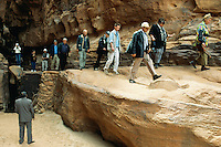 Jordan. Wadi Rum.The Wadi Rum is a large, beautiful and deserted area. Western tourists on line during a visit on foot. he muslim guide watches the entire group.    2002 Didier Ruef