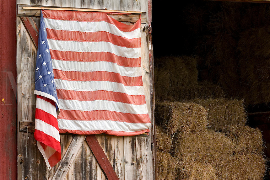 Hay barn and weathered American flag in the White Mountains of New Hampshire