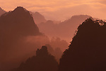 In early morning brisk winds sweep up the sheer cliffs, lifting the mists.