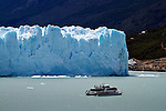 A sightseeing boat nears Glacier Perito Moreno in Parque Nacionales los Glaciares, Argentina.