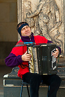 Man playing accordion at the entrance to the Zwinger gardens from Thaterplatz, Dresden, Saxony, Germany
