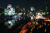 Aug 06, 2009; Hiroshima City, Hiroshima Pref., JPN - The Genbaku Dome is bathed in light during the lantern floating ceremony on the Motoyasu river in remembrance of those who have passed away from as a result of the atomic bombs...Photo credit: Darrell MIho.