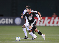 DC United forward Jaime Moreno (99) take possession of the ball follow behind by Kansas City WIzards midfielder Craig Rocastle (4) . DC United defeated The Kansas City Wizards  2-0 at RFK Stadium, Wednesday May 5, 2010.