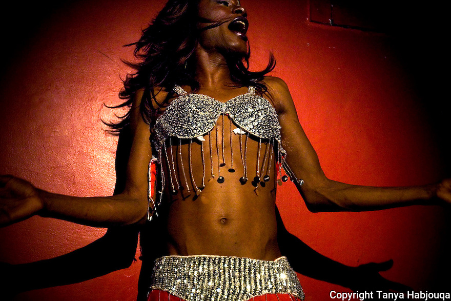 Palestinian drag queen 'Eman' performs an playful belly dance on stage in a gay club in Jerusalem--frequented by Israeli and Palestinian drag queens , where the only wall between the people is a dressing room.