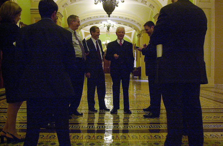 42joint022701 -- Sen. Robert Byrd, D-WV, tells stories to  Sen Bill Nelson, D-FL, and his staff near the Ohio Clock after President Bush's address to the Joint Session of Congress.