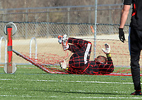 WASHINGTON, DC - February 06, 2012: Bill Hamid of DC United is tangled in the net after making a save during a pre-season practice session at Long Bridge Park, in Arlington, Virginia on February 6, 2013.