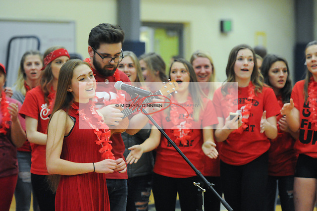 Eagle River Sophomore Class President Kali Spencer and Hunter George lead the combined student governments in a halftime song at the Wolves' vs. Mustangs basketball game Friday, Feb. 3, 2017.  Photo for the Star by Michael Dinneen