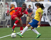 Canadian player Robyn Gayle (5) dribbles as Brazilian player Marta (10) defends. In an international friendly, Canada defeated Brasil, 2-1, at Gillette Stadium on March 24, 2012.