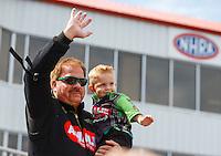 May 15, 2016; Commerce, GA, USA; NHRA top fuel driver Terry McMillen with son Cameron McMillen during the Southern Nationals at Atlanta Dragway. Mandatory Credit: Mark J. Rebilas-USA TODAY Sports