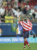 26 August 2004:  Abby Wambach waves to the stands after defeating Brazil,2-1 in overtime at Karaiskaki Stadium in Athens, Greece.  Credit: Michael Pimentel / ISI.