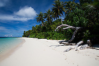 The pristine sand beach on the lagoon side of Eneko Island, Majuro Atoll, Marshall Islands.
