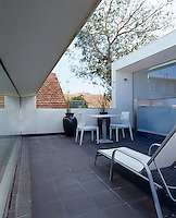 The roof terrace runs the width of the house and  is sandwiched between the double height living area and other domestic spaces