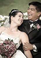 Newlyweds share a laugh during their wedding. (Photo by Scott Eklund)
