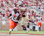 Florida State wide receiver Kermit Whitfield can't hang on to a pass in the endzone in the second half of an NCAA college football game against Syracuse in Tallahassee, Fla., Saturday, Oct. 31.  Florida State defeated Syracuse 45-21. (AP Photo/Mark Wallheiser)