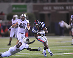 Ole Miss'  Ferbia Allen (83) is tackled by Southern Illinois' Nick King (8) at Vaught-Hemingway Stadium in Oxford, Miss. on Saturday, September 10, 2011.