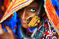 A harijan woman wearing a traditional nose ring called &quot;Velado&quot;. It is a sign that the woman is married and it is worn only on special occasions.