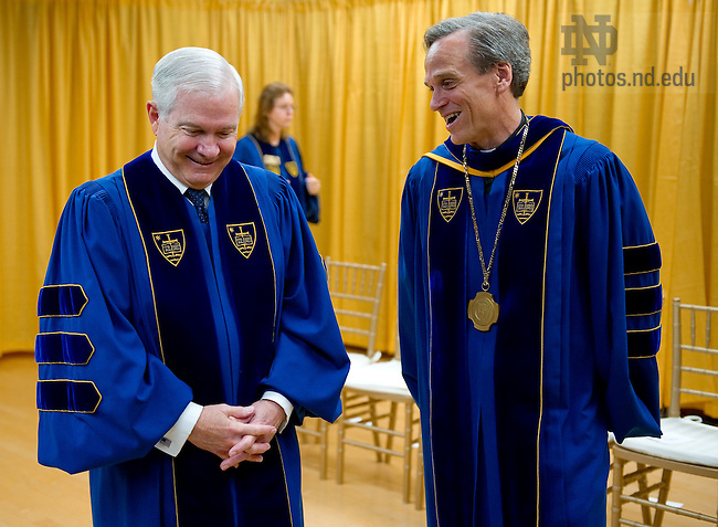 May 22, 2011; Rev. John I. Jenkins, C.S.C., president of the University of Notre Dame chats with U.S. Secretary of Defense Robert Gates before the 2011 Commencement ceremony...Photo by Matt Cashore/University of Notre Dame