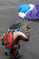 Parachute jumper landing short of target, ending up in the drink. The Extremesport Week, Ekstremsportveko, is the worlds largest gathering of adrenalin junkies. In the small town of Voss enthusiasts in a varitety of extreme sports come togheter every summer to compete and play.© Fredrik Naumann