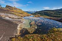 Water drains over granite rock, western Prince William Sound, Chugach National Forest, Kenai mountains, Alaska.